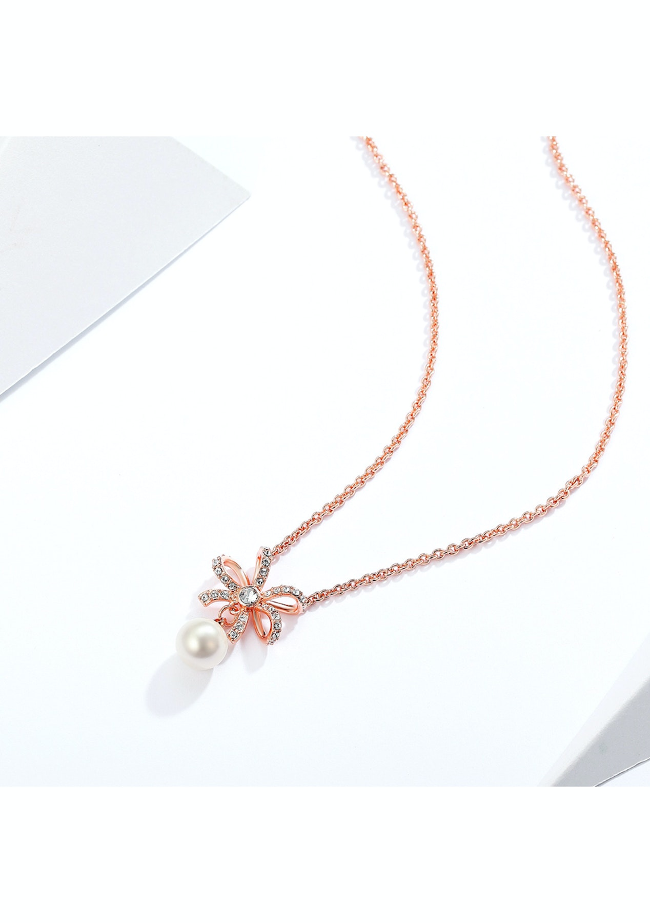 3807e01168292 Krystal Cotoure - Ribbon Bow Pearl Necklace with Swarovski White Crystal  Pearl Rose Gold Plated