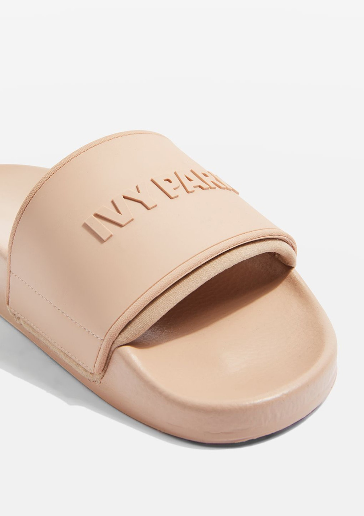 ccc4ed27f208c2 Ivy Park - Neo Lined Embossed Logo Slides - Dusty Pink - Ivy Park - Onceit