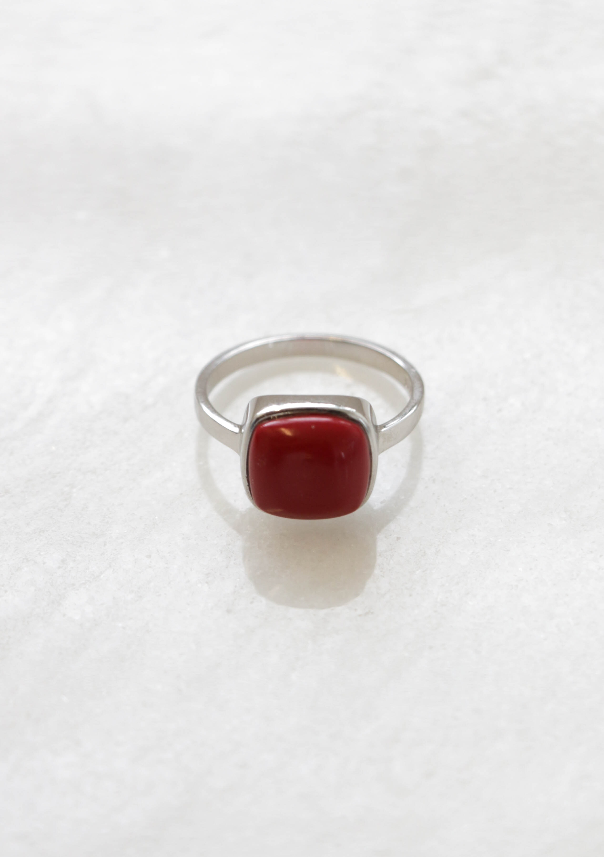 Square red howlite