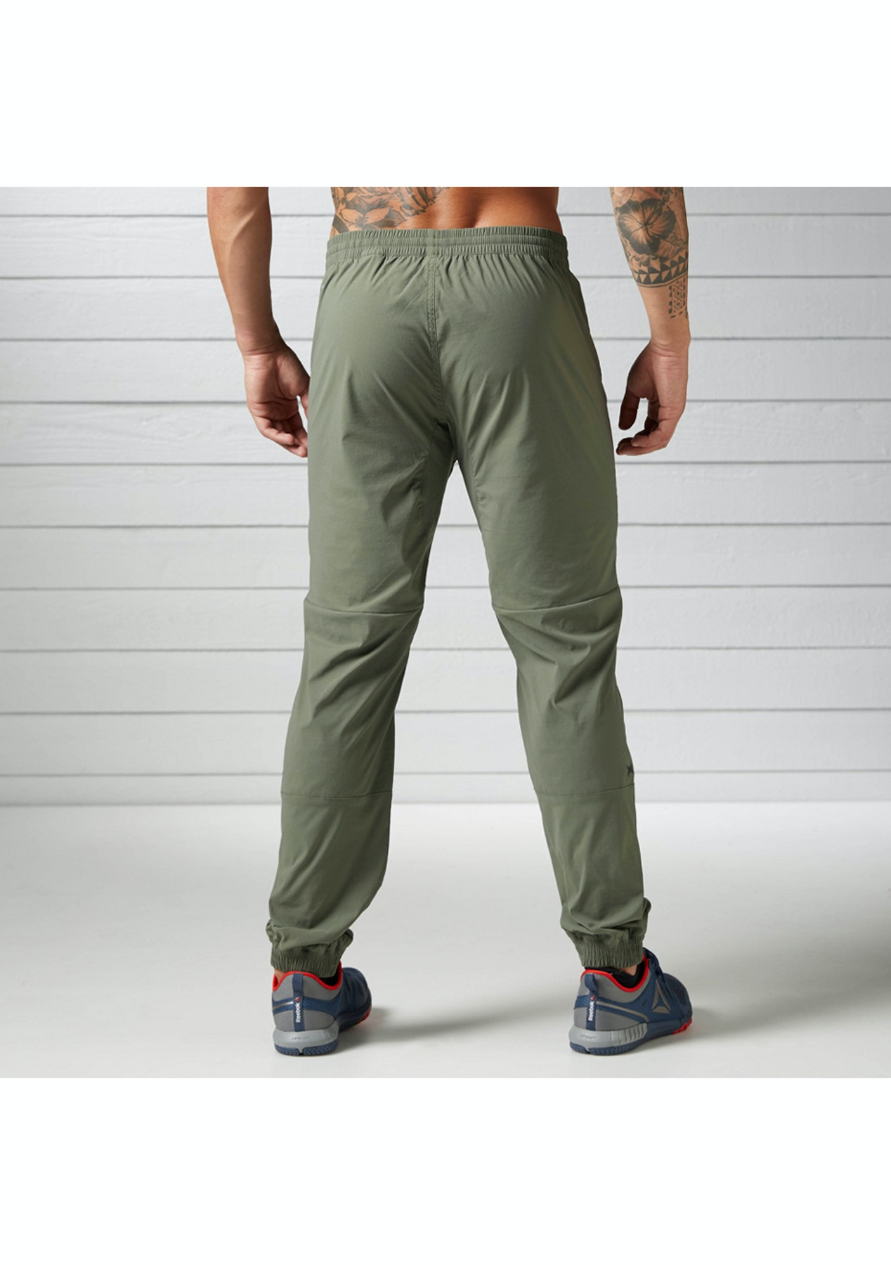 2a3033b92e8d Reebok Mens - Elite Woven Jogger Hungrn - Mens Warehouse - Onceit